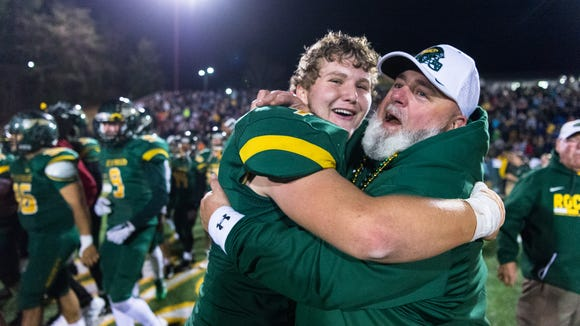 Reynolds' Eli Hembree celebrates following their 28-25