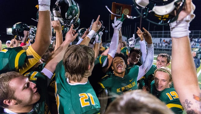 The Reynolds football team celebrates together following their 28-25 win over Sun Valley Friday, December 1, 2017, advancing them to the state championships.