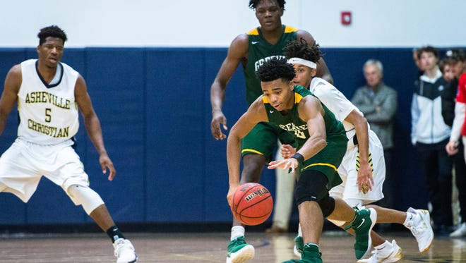 Christ School's Jalen Lecque regains possession of the ball as he dribbles around Asheville Christian Academy's Raishaun Brown during their game Tuesday, January 9, 2018.