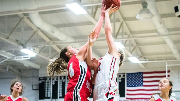 Franklin's Taylor Ensley blocks a shot by Pisgah's