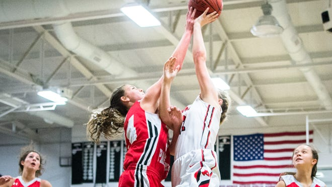 Franklin's Taylor Ensley blocks a shot by Pisgah's Regan Lunsford during their game Friday, January 12, 2018.