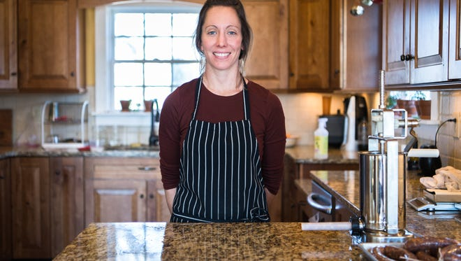 Meredith Leigh, local butcher and cookbook author in her home.