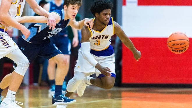 North Henderson and Enka boys basketball teams competed in the WMAC conference tournament game at Erwin high school, Monday, February 12, 2018. Enka defeated North Henderson 74-63.