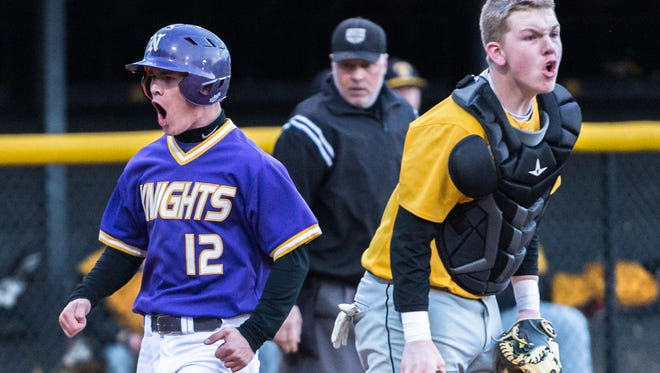 North Henderson's Kyle Decker cheers as he safely crosses home plate during their game against Tuscola Friday, March 9, 2018. North Henderson defeated Tuscola 5-2 in 12 innings.