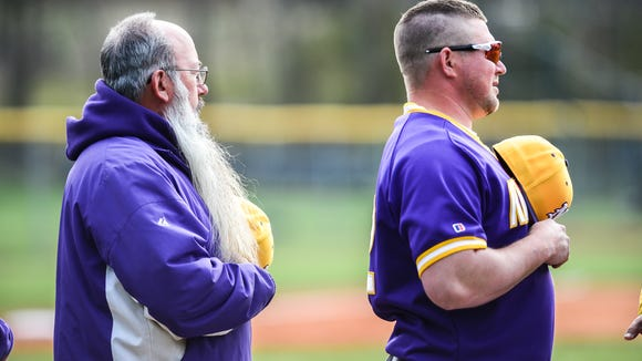 North Henderson baseball coach, John Street, on left, during their game against Tuscola, Friday, March 9, 2018.