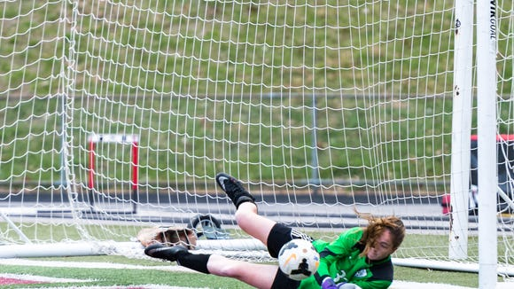 Smoky Mountain goalkeeper  Lucy Miller stops a shot during their game at Asheville Friday, March 23, 2018. Asheville won 5-0.