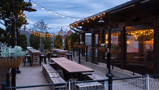 The patio at Pack's Tavern. The city asked the restaurant to unplug the bistro lights shown here to comply with a citywide lighting ordinance.
