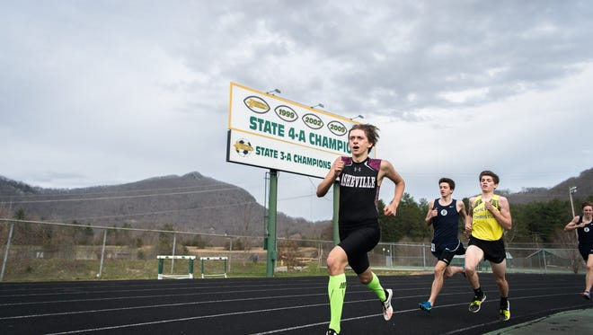 Boys compete in the 1600 meter race at the Buncombe County track and field championships held at Reynolds high school Wednesday, March 28, 2018.