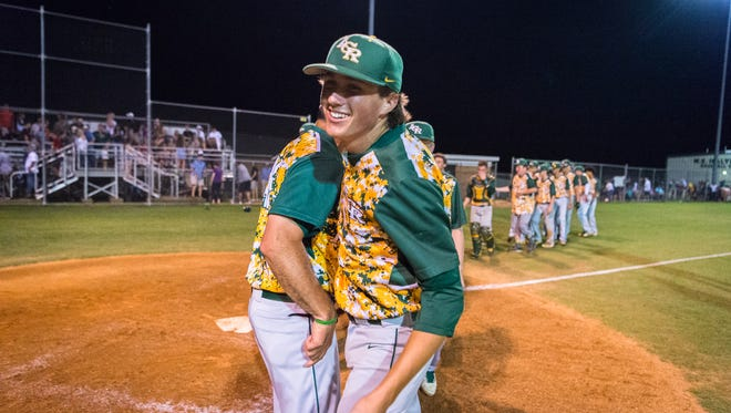 Reynolds celebrates their win over Crest high school in their first game of three in their regional finals series Wednesday, May 23, 2018, defeating Crest 5-1.