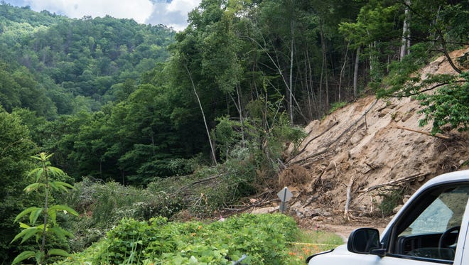 A landslide covers a 100-foot stretch of N.C. 9 near Bat Cave in this photograph taken in mid-June.