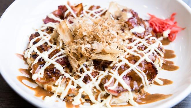 Okonomoyaki with bacon, topped with bonito flakes served at WakuWaku Japanese Eatery on Merrimon Avenue in Asheville.