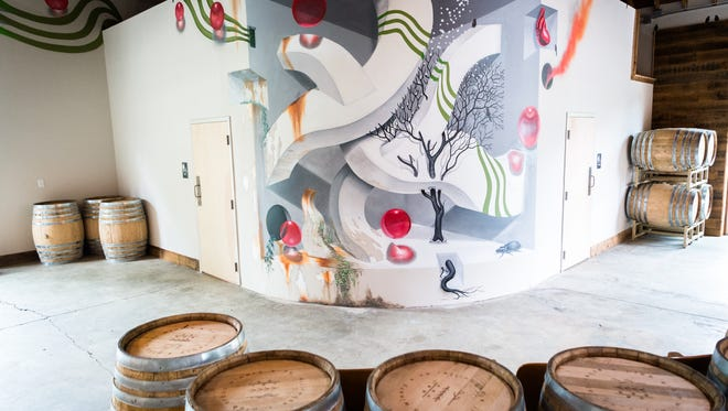 One of the murals created by local graffiti artists inside of plēb urban winery in Asheville's River Arts District which is set to open in September of 2018.