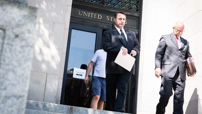 Michael Greene, former Buncombe County business intelligence manager leaves the federal courthouse in Asheville with his attorney Ted Besen after his plea hearing for his guilty plea to a charge of conspiracy to defraud the federal government, Friday, July 27, 2018. He has been ordered to forfeit $11,732.