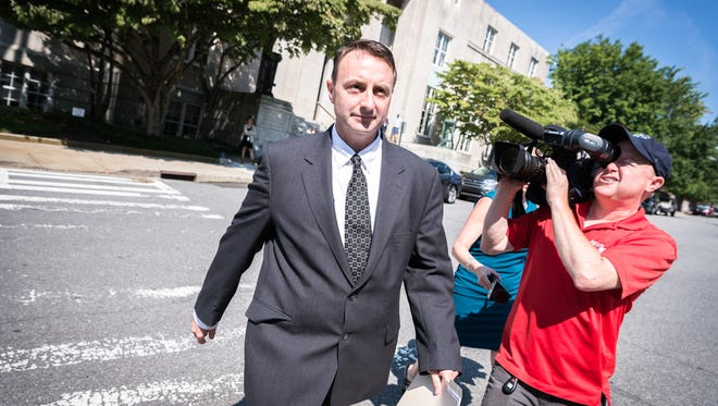Michael Greene, former Buncombe County business intelligence manager leaves the federal courthouse in Asheville after his plea hearing for his guilty plea to a charge of conspiracy to defraud the federal government, Friday, July 27, 2018. He has been ordered to forfeit $11,732.