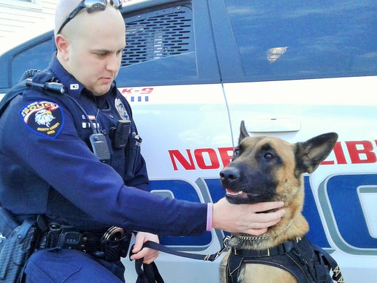 North Liberty's first police dog, Falco, gets a chin