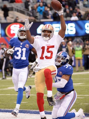 San Francisco 49ers wide receiver Michael Crabtree (15) scores the game winning touchdown during the second half against the New York Giantsat MetLife Stadium.