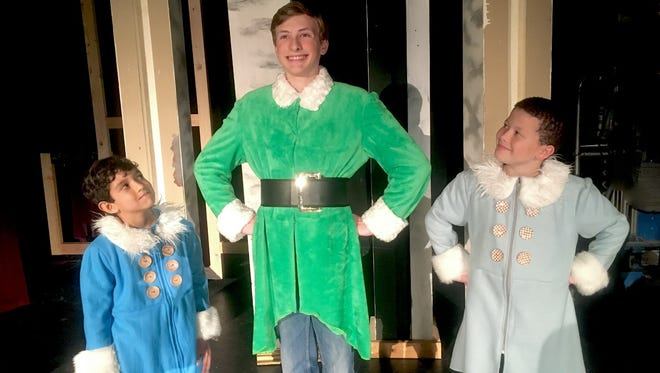 """Josiah Massey, Alex Duke and Jaden Allen (from left) rehearse for """"Elf Jr., the Musical,"""" which opens Nov. 18 at the Wichita Theatre. Duke plays Buddy the Elf, who grows up at the North Pole but discovers he's human."""