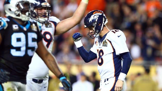 Feb 7, 2016; Santa Clara, CA, USA; Denver Broncos quarterback Peyton Manning (18) celebrates after a two-point conversion against the Carolina Panthers in the fourth quarter in Super Bowl 50 at Levi's Stadium. Mandatory Credit: Mark J. Rebilas-USA TODAY Sports
