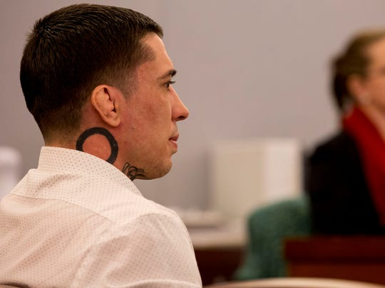 Former mixed martial arts fighter War Machine, also known as Jonathan Koppenhaver, listens to the testimony from victim and ex-girlfriend Christine Mackinday during his sexual assault and attempted murder trial at the Regional Justice Center on Wednesday  in Las Vegas.