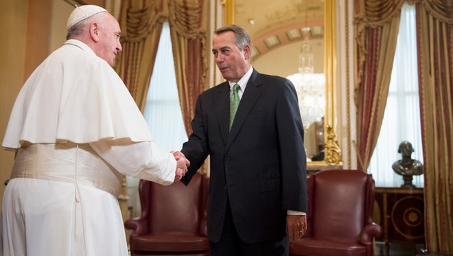 House Speaker John Boehner of Ohio greets Pope Francis on Capitol Hill in Washington, Thursday, Sept. 24, 2015, as the Pope arrived before addressing a joint meeting.