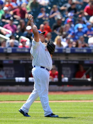 Mets starting pitcher Bartolo Colon stretches his arm during the fifth inning against the Philadelphia Phillies at Citi Field. The Mets defeated the Phillies 6-3, and Colon earned his seventh win of the season.