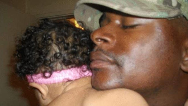 Mississippi National Guard Sgt. Stanley Hoskins hugs his daughter, Isabella, goodbye before returning to Afghanistan in 2012.