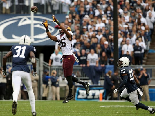 Minnesota's Brian Smith (26) hauls in pass against Penn State during the first half of an NCAA college football game in State College, Pa., Saturday, Oct. 1, 2016. (AP Photo/Chris Knight)
