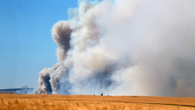 A fast-moving fire continues to rage across Wasco County southeast of The Dalles, Ore., Wednesday, July 18, 2018. The blaze Wednesday doesn't bode well for a Pacific Northwest fire season that's expected to be worse than normal. The region has seen drought conditions in many areas.