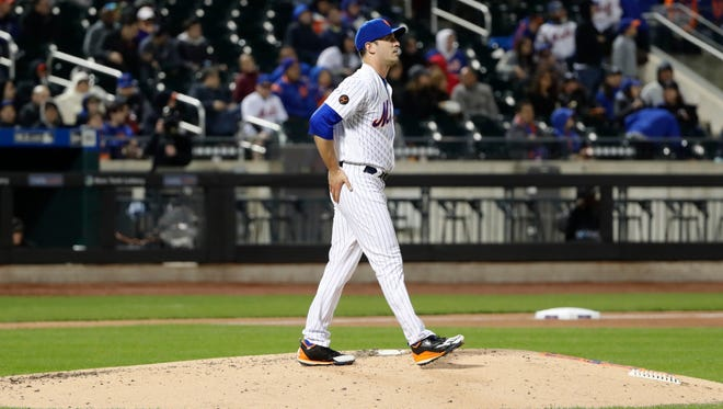 New York Mets starting pitcher Matt Harvey reacts after Milwaukee Brewers' Jett Bandy hit a home run during the fourth inning of a baseball game Saturday, April 14, 2018, in New York.