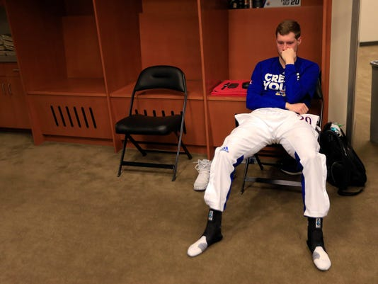Kansas guard Tyler Self sits in the locker room after the team's Midwest Regional final against Oregon in the NCAA men's college basketball tournament, Saturday, March 25, 2017, in Kansas City, Mo. Oregon won 74-60. (AP Photo/Orlin Wagner)