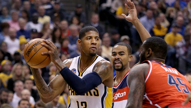 iIndiana Pacers forward Paul George (13) drives around Washington Wizards guard Garrett Temple (17) in the first  half of their game Friday, Jan 15, 2016, evening at Bankers Life Fieldhouse. The Pacers lost to the Wizards 104-118.