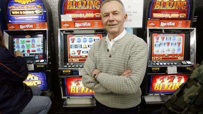 Merlyn Linn of Linn's Super Market in Des Moines is shown with TouchPlay machines from the Iowa Lottery in this 2006 photo.