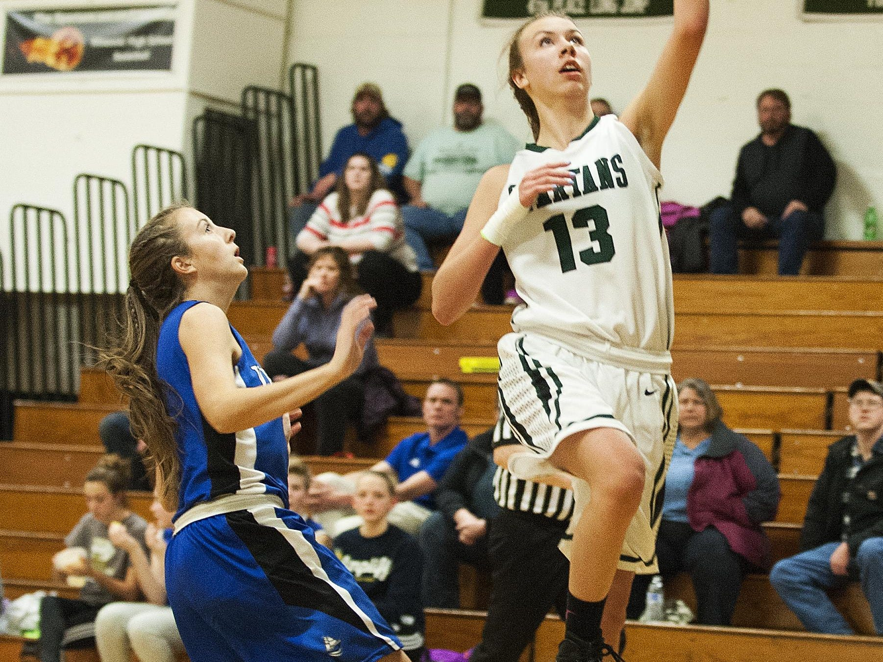 Winooski's Riley Corrigan (13) leaps for a lay-up during the girls basketball game between Vergennes and Winooski at Winooski High School on Wednesday.