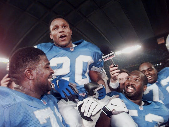 Detroit Lions running back Barry Sanders gets a ride