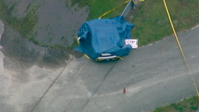 This aerial image taken from a video provided by WFTV shows the scene after a deadly crash at the Exotic Driving Experience at Walt Disney World on Sunday, April 12, 2015, in Orlando. A Lamborghini that was part of an exotic car racing attraction at Walt Disney World crashed into a guardrail, killing a passenger and injuring the driver.