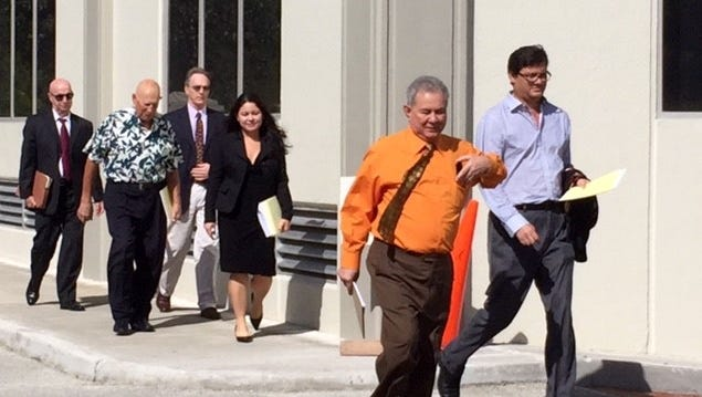 In this file photo, attorneys for plaintiffs and defendants in 155-plus Guam clergy sex abuse lawsuits emerge from the U.S. District Court building after a first joint status conference for cases filed in local and federal court. Another joint status conference hearing is set for June 5.