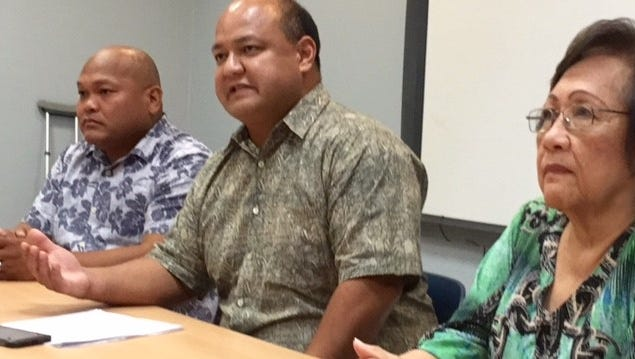 Education Superintendent Jon Fernandez, center, talks about further costcutting measures in the Guam Department of Education, while Guam Education Board Chairman Mark Mendiola, left, and Vice Chairwoman Maria Gutierrez, right, look on during a press conference Wednesday in Tiyan.