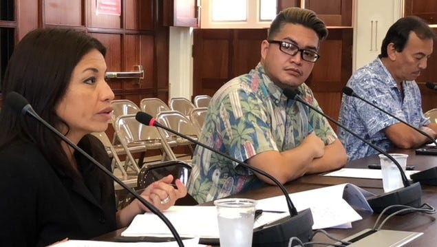 Guam Hotel and Restairant Association President Mary Rhodes, left, on Wednesday afternoon testifies in favor of a bill seeking to immediately tax short-term vacation rentals without the current law's requirement of a new set of Department of Revenue and Taxation rules and regulations. Also in photo are Guam Visitor Bureau's Tony Muna, center, and Revenue and Taxation Director John Camacho, right.