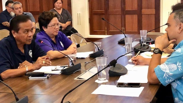 Department of Public Health and Social Services Acting Director Leo Casil, left, on Tuesday answers questions from Sen. Dennis Rodriguez, right, and other senators about the status of the medical marijuana program.
