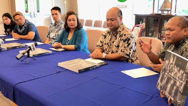 Guam Education Board Chairman Mark Mendiola, right, on Wednesday gestures as he talks about Guam's hosting of the 2016 Festival of the Pacific Arts and the images from that event captured in a book, copies of which have been made available by the Guam Visitors Bureau to public schools. Looking on are tourism and education officials.