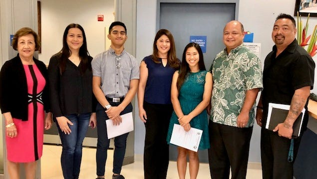 From left, Guam Education Board Vice Chairwoman Maria Gutierrez, Leilani Navarro, Lorenzo Jorolan, Miriam Rupley, Taryn Rupley, Education Superintendent Jon Fernandez, and John F. Kennedy High School Assistant Principal Kin Fernandez, during Thursday's announcement that JFK High students Jorolan and Taryn Rupley will get free government of Guam accrued air miles they can use for their air fare to Maryland and California, respectively, to attend national student conferences this summer.