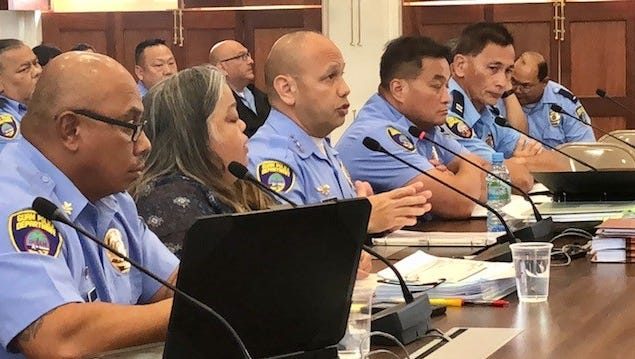 Chief of Police Joseph I. Cruz, center, gestures as he answers a question from senators during Friday's hearing on the Guam Police Department's proposed fiscal 2019 budget. Senators asked police officials about the transfer of nearly $167,000 from GPD's special funds to the General Fund, and reminded the department to not allow these funds to be raided again for other uses.