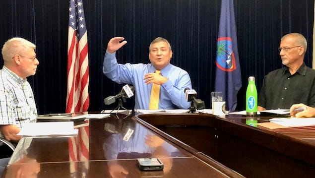 Gov. Eddie Calvo, center, gestures as he talks about the latest amendments to a proposed fiscal 2019 budget bill that senators are currently working on, while Department of Administration Director Edward Birn, left, and Bureau of Budget and Management Research Deputy Director Lester Carlson, right, look on during an Aug. 6, 2018 press conference at Adelup.