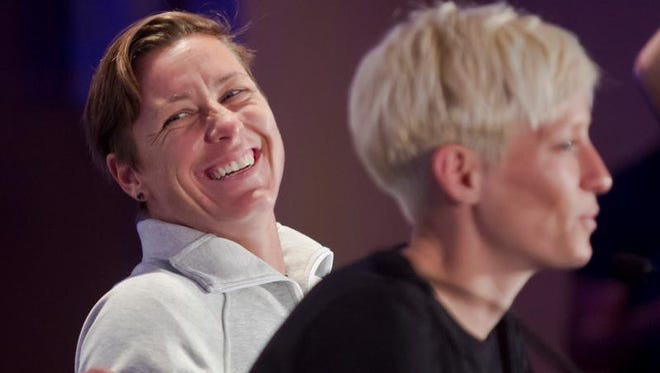 United States women's soccer player Abby Wambach, left, laughs as Megan Rapinoe, right, speaks during the U.S. women's national team World Cup media day, Wednesday, May 27, 2015, in New York. The U.S. will face South Korea on Saturday, May 30, at Red Bull Arena in their final send-off match, before leaving for Canada and the 2015 FIFA Women's World Cup.