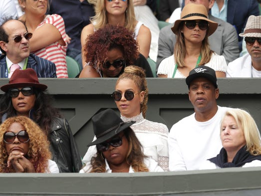 Beyoncé and Jay Z follow the action during Serena Williams'