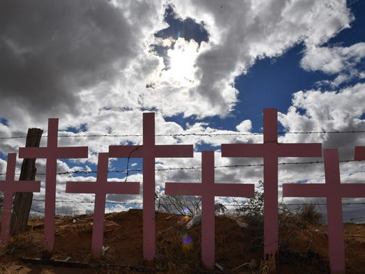 Crosses placed in memory of eight victims of feminicide