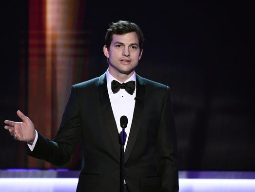 Ashton Kutcher presents the award for Outstanding Performance