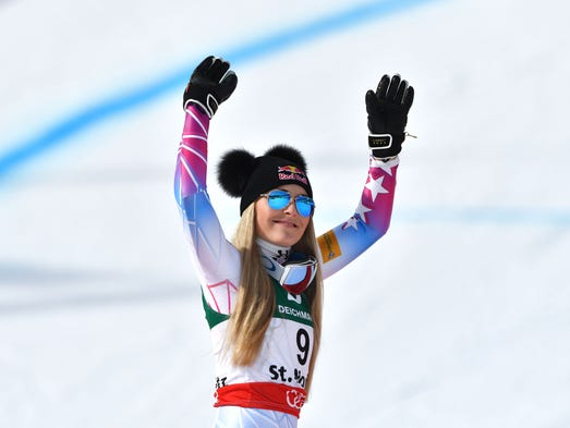Lindsey Vonn celebrates finishing third in the women's