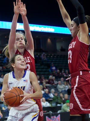 Northern Iowa's Madison Weekly (2) looks to pass as Bradley players defend Friday during their Missouri Valley Conference tournament game.