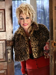 "Dolly Parton as The Painted Lady in ""Christmas of Many Colors: Circle of Love."""